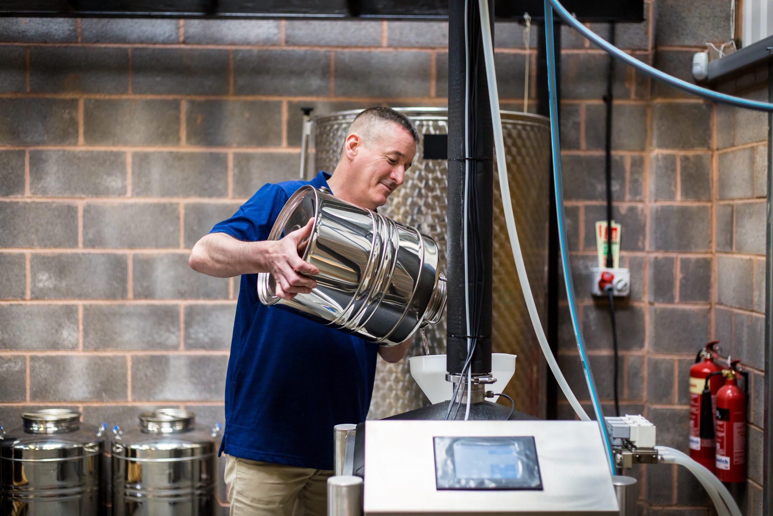 John working in the Distillery